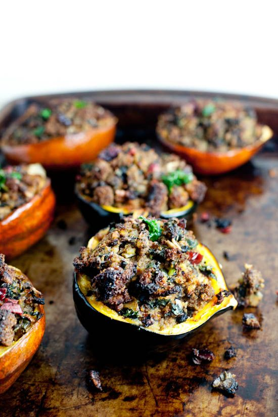 Acorn squash stuffed with gluten free cornbread stuffing is a great healthy vegan entrée for Thanksgiving or festive weeknight dinner.
