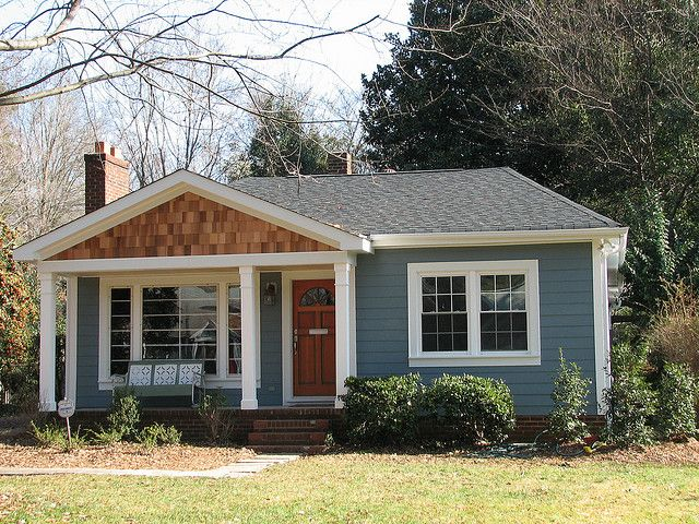 We like the color and look of the siding on this one - slate blue/grey, simple plank. Matt does not like the cedar shingles, FYI.