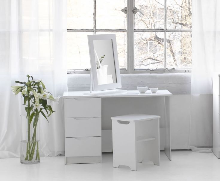 white corner dressing table and stool