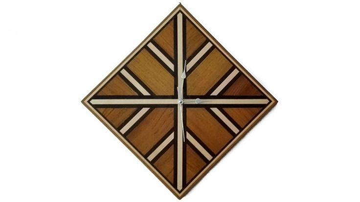 Rhombus wall clock. Wooden clock rhombus' shaped, made by hand using the inlay technique.