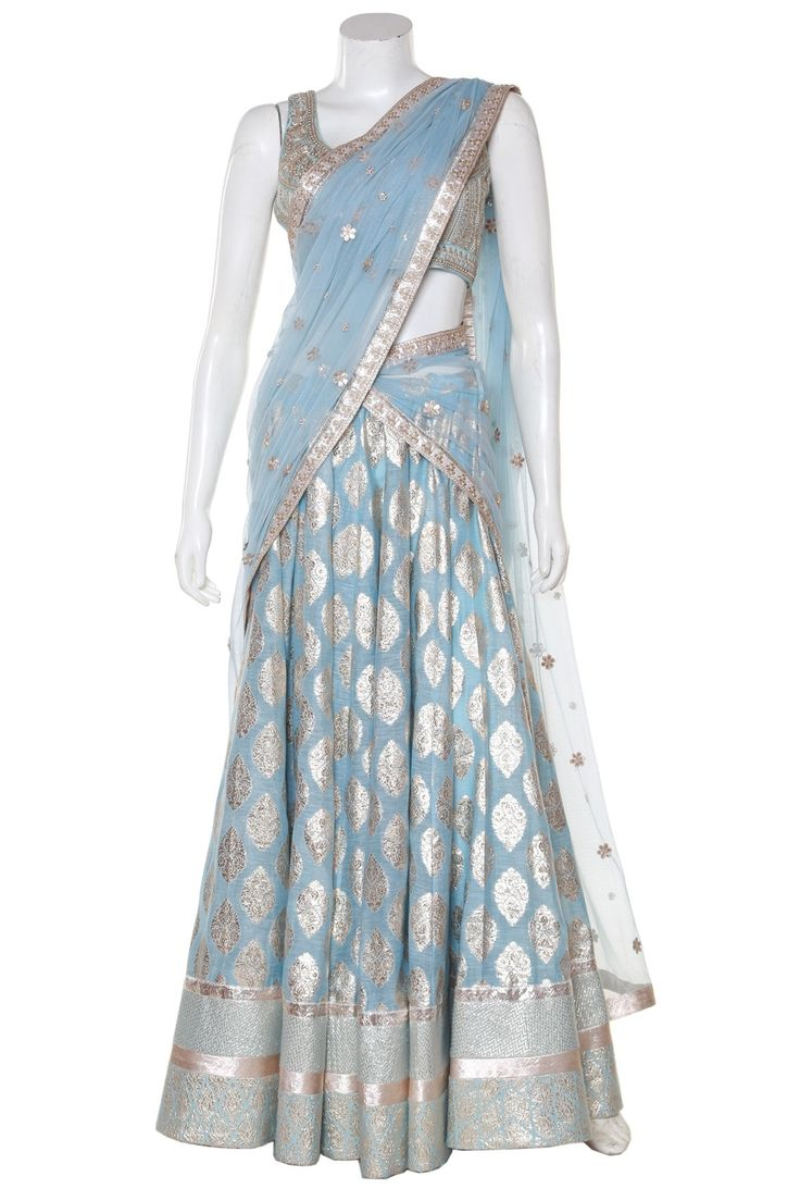 The lehenga in a handwoven fabric from the interiors of the sacred city of banaras. You will love the pretty gold motifs over the traditional choli and the gracefully embroidered dupatta in the traditional handart of gota patti from Rajasthan.