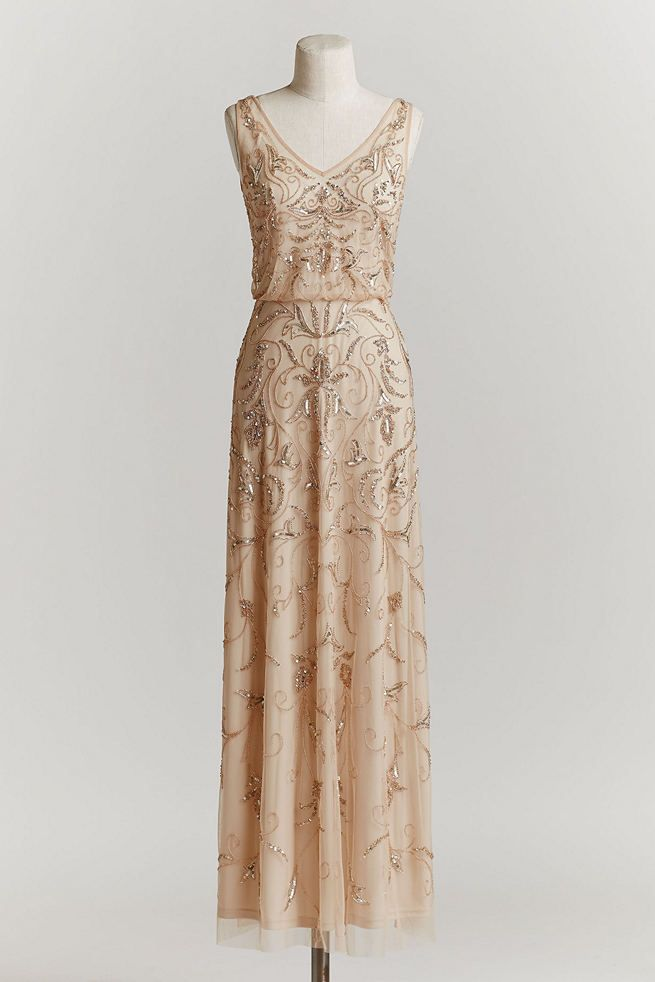 Vintage Wedding Dress: With a blouson silhouette and beads and sequins stitched upon champagne tulle, this vintage wedding dress evokes the era of brass bands and unbridled extravagance