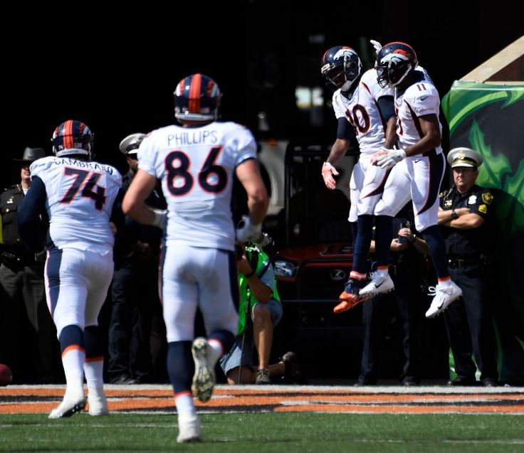 Denver Broncos wide receiver Emmanuel Sanders (10) celebrates with Denver Broncos wide receiver Jordan Norwood (11) after his touchdown catch on Cincinnati Bengals cornerback Adam Jones (24) and Cincinnati Bengals free safety George Iloka (43) during the first quarter September 25, 2016 at Paul Brown Stadium. John Leyba, The Denver Post