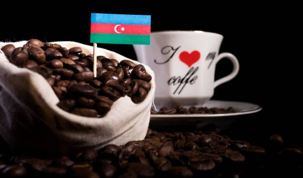 azerbaijan flag in a bag with coffee beans isolated on black