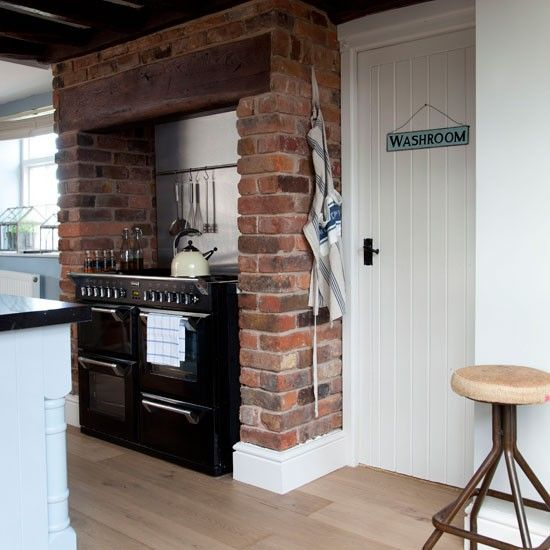 Bricks.  Chimney breast.  ((Rustic raw-brick kitchen | housetohome.co.uk))