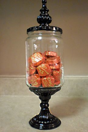 I LOVE this idea!! These are made from pickle jars!! Glued onto a spray painted dollar store candle holder, decorative finneal added on top. Can fill with candy prior to giving as gift! Can be used in kitchen as candy, tea, or anything storage, or in the bathroom as Q-tip & cotton ball storage. Awesome!