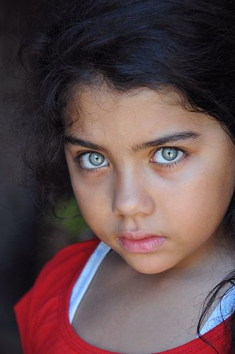 Egyptian Girl Portrait. Cute little Girl ....captured with natural light ....This Photo was taken in Temple of Karnak Luxor.