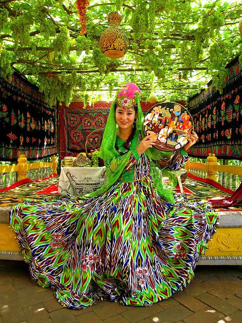 An Uyghur woman in kaleidoscopicy awesome traditional costume. The Uighurs are a large minority group in China and are Muslim, so China often blames any ethnic unrest in this region on religion.