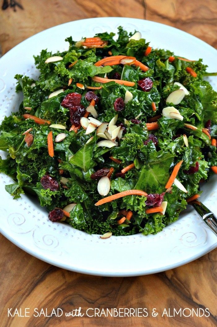 Kale Salad with Cranberries & Almonds Recipe: The secret to making this gorgeous and healthy kale salad delicious is massaging the kale. See how in this post.