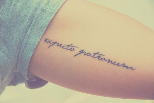 """Harry Potter. The dementor is a metaphor for depression and the patronus is the feelings of hope and love that fight against it. Actually a beautiful meaning and great tattoo. It translates to """"I await a guardian""""."""