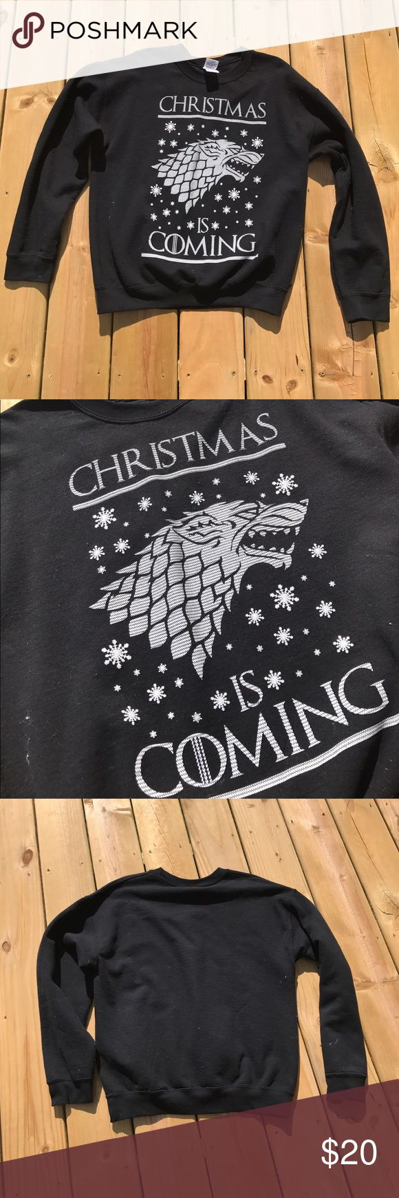 """Game of Thrones - Christmas is Coming Sweater. Game of Thrones - Christmas is Coming Sweater. Navy crew neck sweatshirt with house stark family cress on front and """"Christmas is Coming"""" in white screen print. Tops Sweatshirts & Hoodies"""