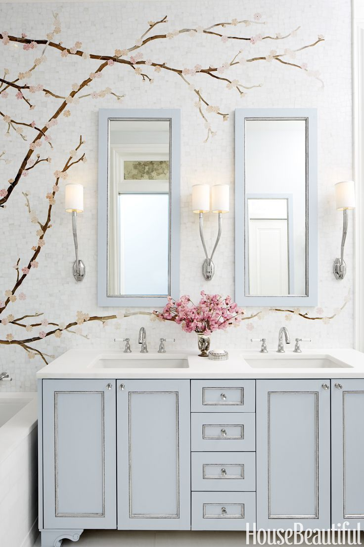 Bathroom with double sink and pale blue woodwork, cherry blossoms, ann sacks