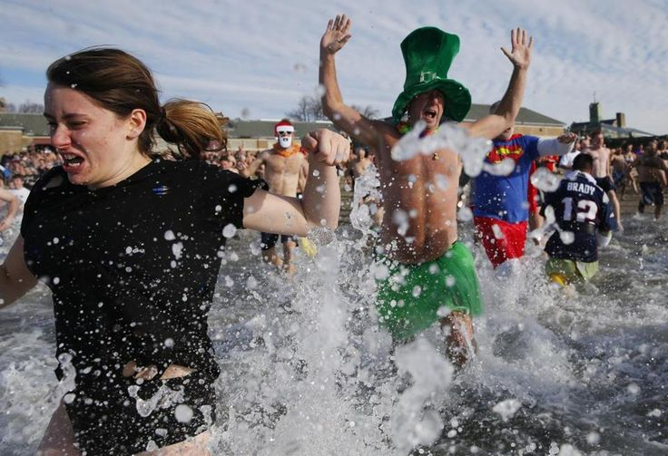 Boston Globe - Nearly 1,000 people join L Street Brownies for annual New Year's Day swim