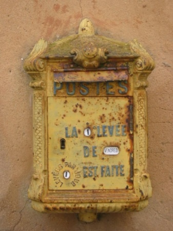 Antique Mailbox. Put your mail in and the mailman has a key.