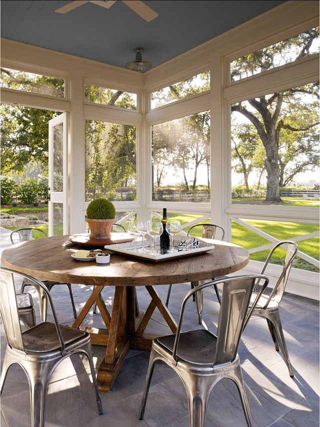 Screened Porch. Great Screened Porch design. Can you picture yourself eating your meals here? Take the views in… I love the trees, the fence… you can almost feel the fresh breeze. #ScreenedPorch #Porch #Patio - Modern Farmhouse