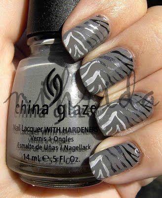Zebra nails on (china glaze - recycle) base. For my cousin Rachel.