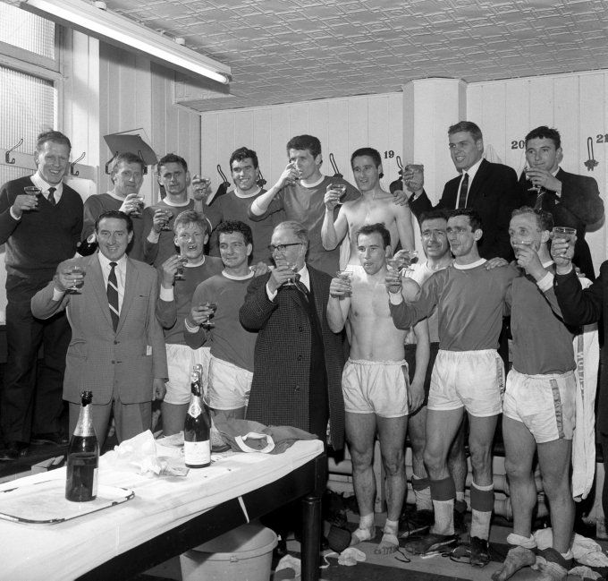 Everton are champions in 1963 and Harry Catterick and players celebrate with champagne in the Goodison Park dressing room.