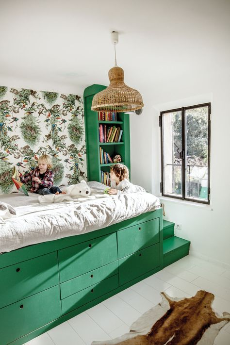 Green kids bedroom with raised bed and storage underneath