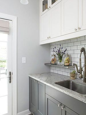 laundry room with gray lower cabinets, white upper cabinets, gray walls