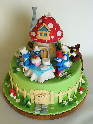 Nerdiest Smurf cake with mushroom house and Azrael the cat