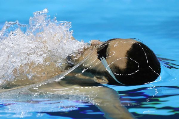 Hamdan Bayusuf of Kenya competes in the men's 100-meter backstroke heat on Day 2 of the Rio 2016 Olympic Games at the Olympic Aquatics Stadium on Aug. 7, 2016 in Rio de Janeiro, Brazil.