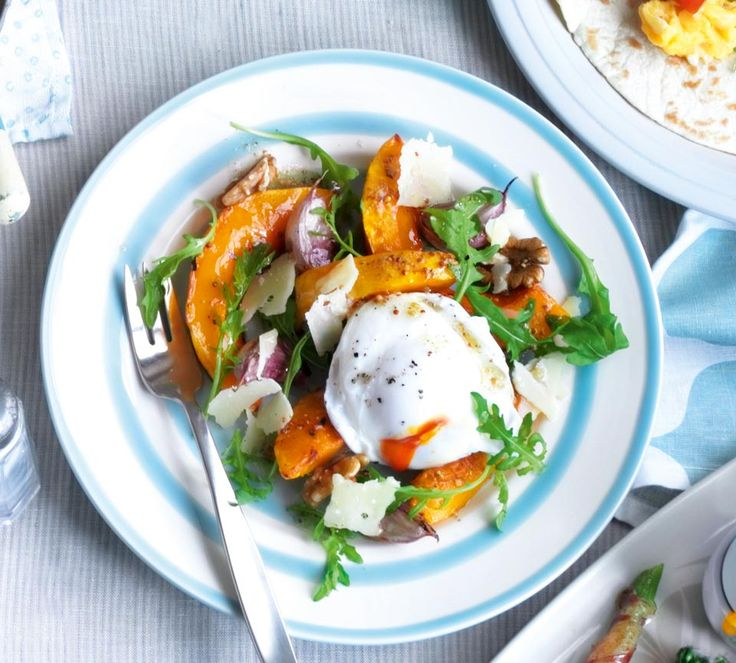 Enjoy seasonal squash in this warm salad recipe with walnuts and poached egg.