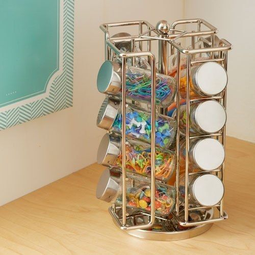 Fill an inexpensive spice rack with office supplies to organize your desk.