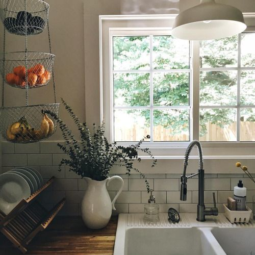The hanging baskets for fruit, the drying rack for dishes, and the cup holder for soap and sponges! I love this!