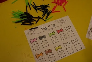 "Dig up the ""bones"" (pipe cleaners). Record the color and number of each."