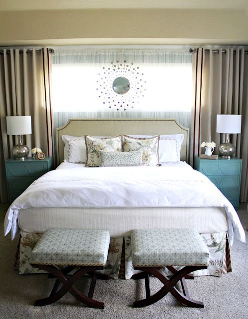 like the colored side tables, little footstools and sheer/solid curtain combo...headboard is cute but a little boaring of a color for me...this blue with grey may be nice...I also liek the printed skirt and throw pillows to match...if you have to do a skirt at all.