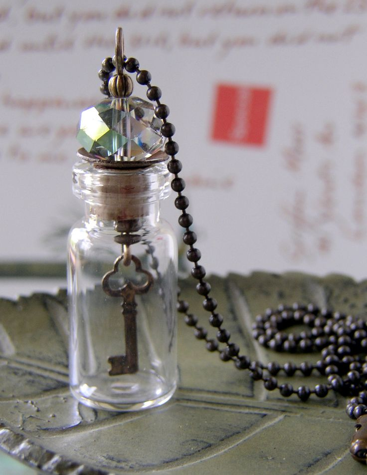 Glass Vial Necklace with Sparkly Glass Bead and Dangling Key Charm. $20.00, via Etsy.