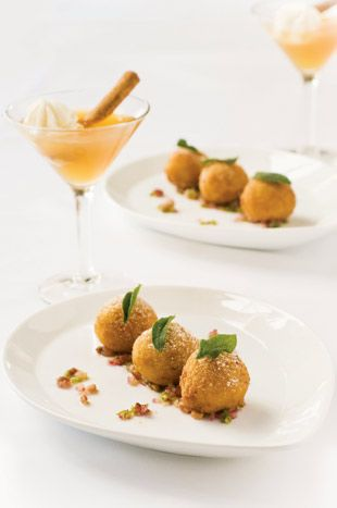 Arancini de riso with butternut squash, sage, mascarpone, and brown butter pancetta vinaigrette paired with a pumpkin martini with cream liqueur, vanilla vodka, pumpkin spice syrup, and garnished with whipped cream and a cinnamon stick. #shopfesta