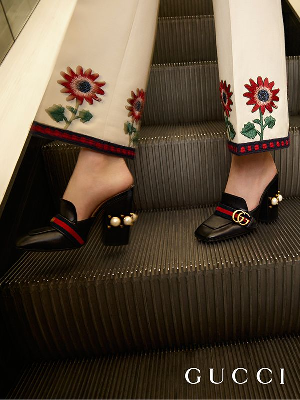 The double G antique gold hardware is set on a blue/red/blue Web on the new Gucci leather high heel mules. The stacked heel is enriched with a row of GG pearls and studs.