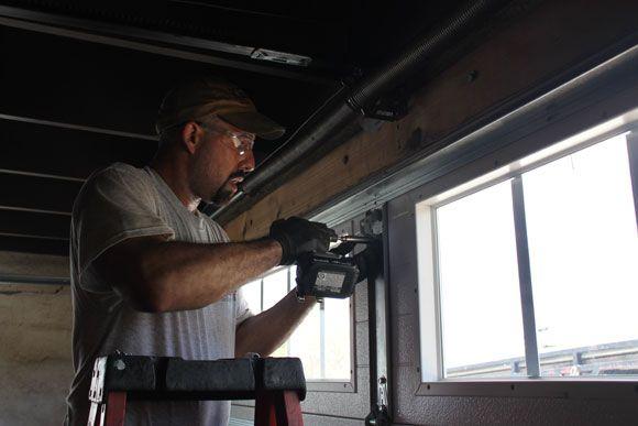 Photo #7 : Installing the new Clopay Gallery Collection garage door. www.clopaydoor.com
