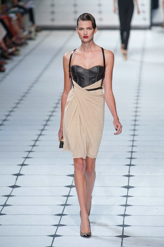 Jason Wu Spring 2013. Leather harness, black corset, and drapey skirt. Just wow.