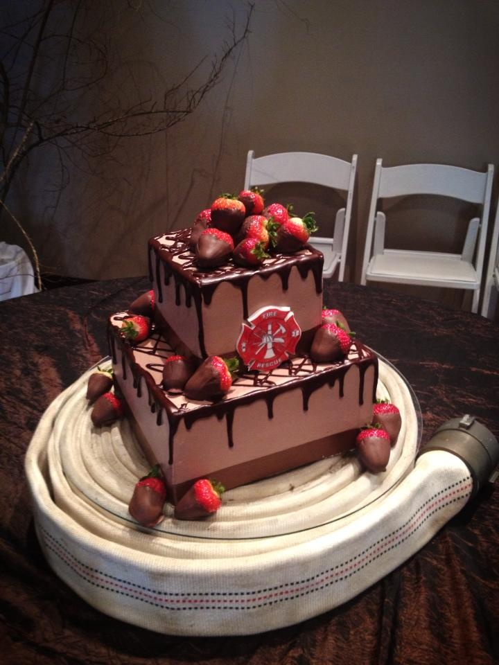 Fireman, fire hose chocolate covered strawberries groom's cake