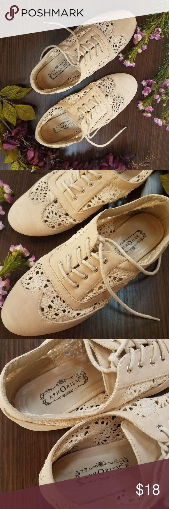 Crocheted Lace oxfords Cream colored lace-up Oxfords. Whimsical crocheted lace detailing. I got complimented every time I wore these! But they just don't match enough of my wardrobe. Please see photos for signs of wear. There is one spot that is a tiny bit undone (3rd to last pic) but  it's not noticeable unless you're examining them. Also a spot of discoloration (2nd to last pic) but I have not tried washing them so I'm not sure if it will come out. Aphorism Shoes Flats & Loafers