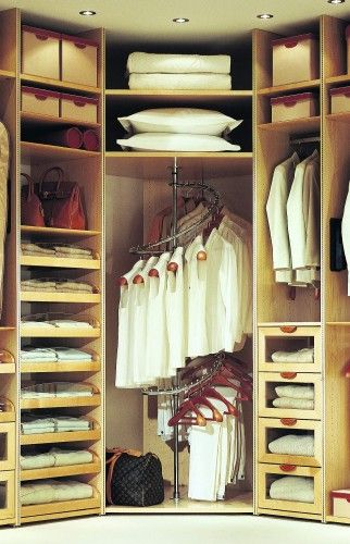 the all white wardrobe is weird but a the spiral rack is a good idea for finding hanging space...