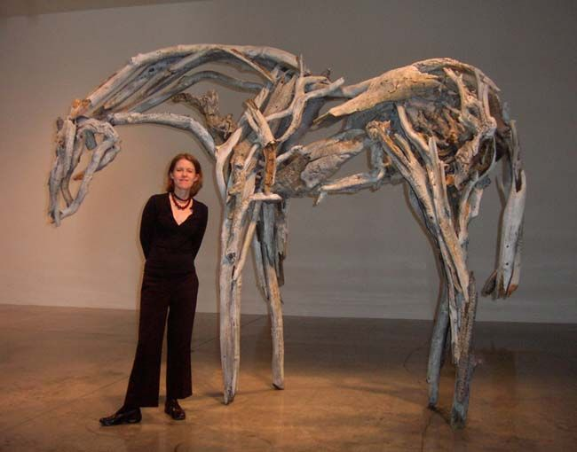Deborah Butterfield with one of her life-size horse sculptures. It's easier to get your mind wrapped around the size of her sculptures with her standing next to one.