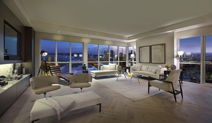 Classic contemporary living room with a stunning view of the lake and the city. Furniture and artwork from Elte #elte #eltecarpet, Design Within Reach #designwithinreach, PI Creative Arts #PIcreativearts and Upcountry #upcountry. #tridel #luxurycondo #luxurylivingroom #tridelmodelsuite #300front #atmosphere #TOSkyline