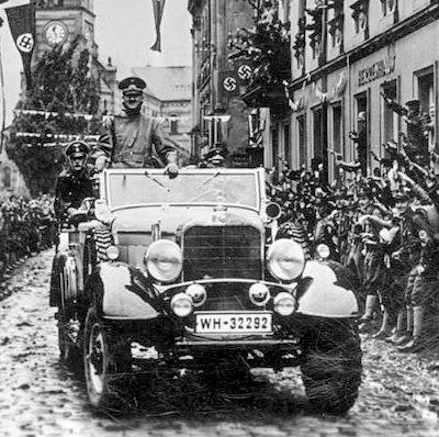 Amid much fanfare, a delighted Führer passes through the town of Graslitz in the Sudetenland on October 4th, 1938