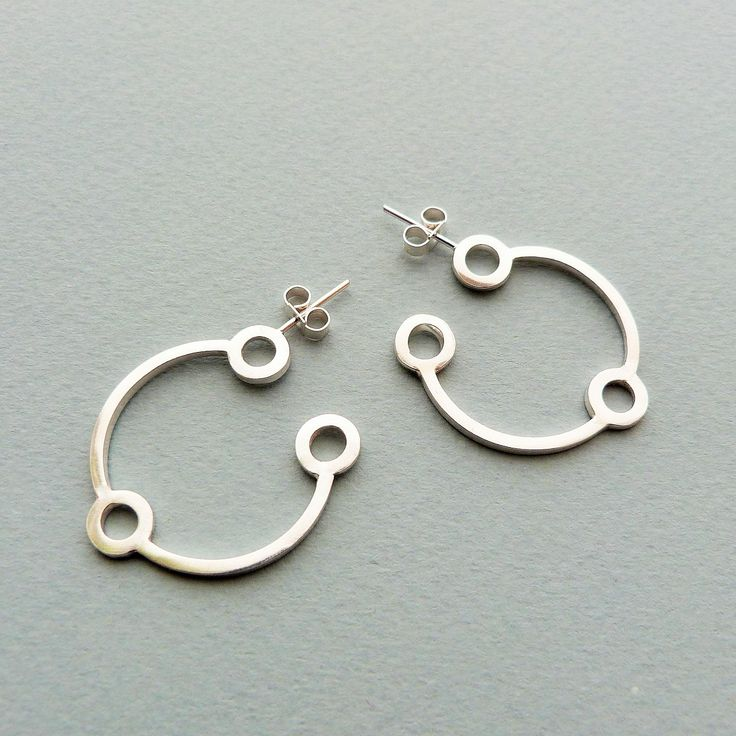 Small atomic hoops in silver // Minimal luxe handmade jewellery by Elin Horgan