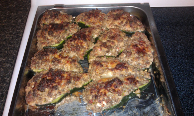 My newly invented recipe! Plablano peppers stuffed with cream cheese, parmesan cheese, wild hog sausage (specially seasoned), jalepenos, and red peppers! Yummmmmmmy!!!!!