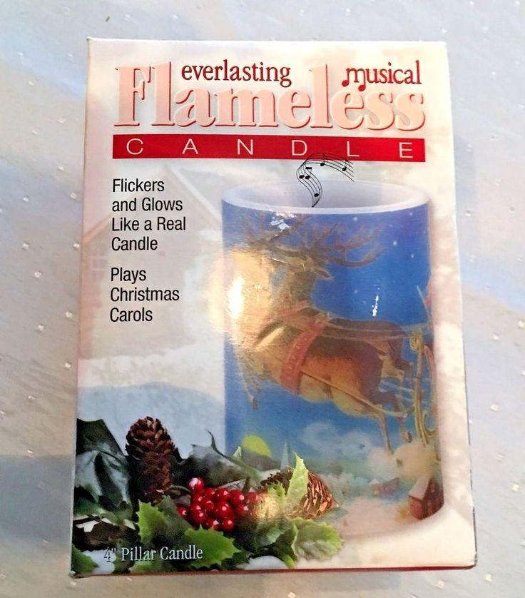 Everlasting Musical Flameless Candle Flickers & Glow Plays Christmas Carols  #MarkFeldstien