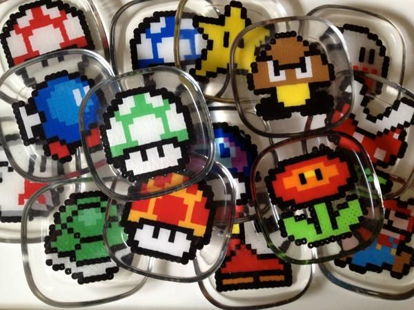 Super Mario Bros. coasters made from perler beads encased in epoxy resin