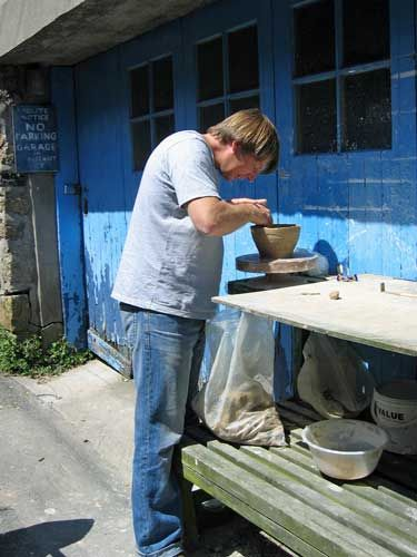 Mousehole Artist Essex Tyler potting outside his old Gallery