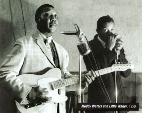 A great and timeless picture of two Chicago blues greats. Little Walter & Muddy Waters....