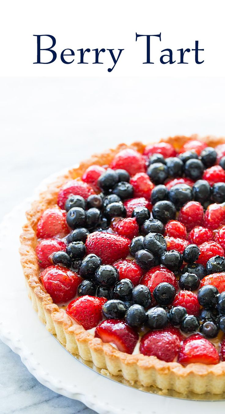 Summer berry tart! Loaded with blueberries, strawberries, and raspberries. A beautiful tart for a gathering. Everyone LOVES this! It's a lot easier to make than you think. On SimplyRecipes.com