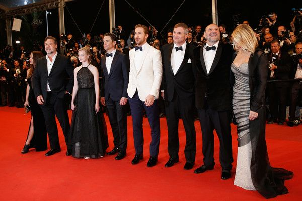"Actress Murielle Telio, Actor Russell Crowe, actress Angourie Rice, actor Matt Bomer, actor Ryan Gosling, director Shane Black, Producer Joel Silver and his wife attend ""The Nice Guys"" premiere during the 69th annual Cannes Film Festival at the Palais des Festivals on May 15, 2016 in Cannes, France."
