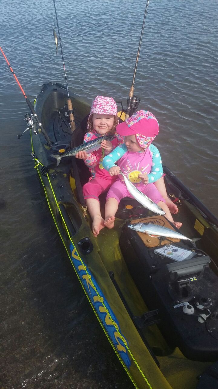 Mia & Ella on Daddy's kayak with his catch of mackerel in Cork.